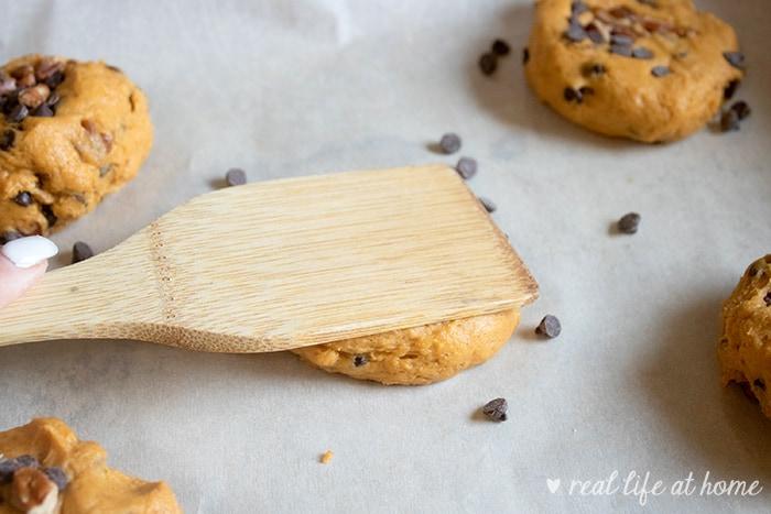 Flattening Pumpkin Chocolate Chip Cookies for Proper Baking